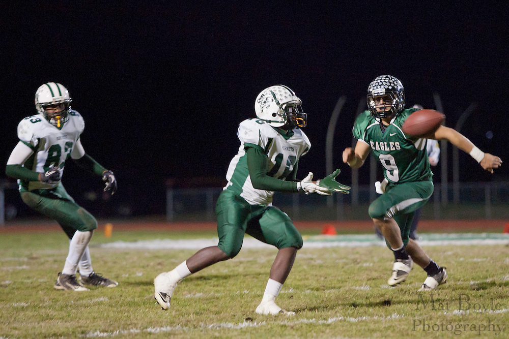 Pemberton High School's Carlton Wright (16), West Deptford High School's Phil Fisher (9)..NJSIAA South Jersey Group 2 first round playoff game Pemberton High School at West Deptford High School on Friday November 11, 2011. (photo / Mat Boyle)