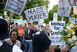 June 16, 2017 - Kensington, England, United Kingdom - Over a thousand people gather outside the department for communities and local government to demand justice for the victims of the fire that destroyed Grenfell tower in west Kensington, UK, on 16 June 2017. Later, demonstrators marched toDowning street (Credit Image: © Jay Shaw Baker/NurPhoto via ZUMA Press)