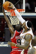 Apr 19, 2010; Cleveland, OH, USA; Cleveland Cavaliers forward LeBron James (23) blocks Chicago Bulls forward Luol Deng (9) during the second period in game two in the first round of the 2010 NBA playoffs at Quicken Loans Arena. Mandatory Credit: Jason Miller-US PRESSWIRE
