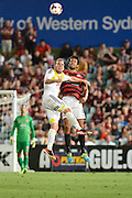 01.01.2014 Sydney, Australia. Wellingtons forward Jeremy Brockie and Wanderers defender Nikolai Topor-Stanley in action during the Hyundai A League game between Western Sydney Wanderers FC and Wellington Phoenix FC from the Pirtek Stadium, Parramatta. Wellington won 3-1.