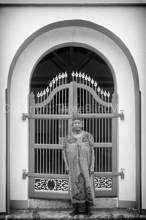 SRI LANKA. Lady in front of her home, Point Pedro, Jaffna.