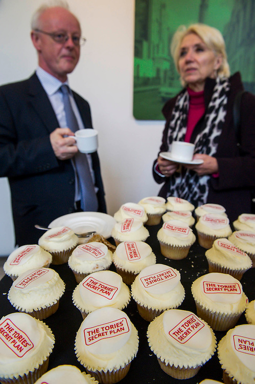 Wellcomed with cup cakes and fake dossiers - Ed Miliband, Ed Balls and Rachel Reeves event addressing the Tory threat to family finances. Royal Institute of British Architects, London, UK 29 Apr 2015.