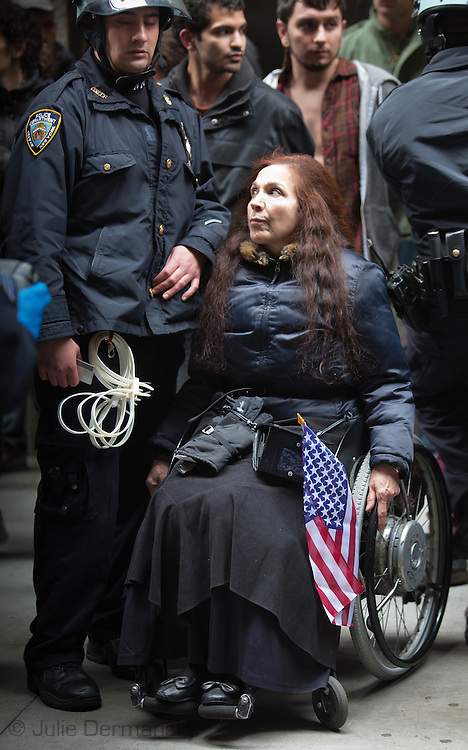New York, NY- November 17th, Nadina Laspina in her wheelchair arrested while protesting with the Occupy Wall Street movement a few blocks from the New York Stock Exchange. Hundreds of Occupy Wall Street activists try to shut down Wall Street on the movements second month anniversary tying up traffic and blocking streets down town.