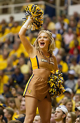 Feb 20, 2016; Morgantown, WV, USA; A West Virginia Mountaineers cheerleader performs during the first half against the Oklahoma Sooners at the WVU Coliseum. Mandatory Credit: Ben Queen-USA TODAY Sports