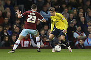 Gaston Ramirez of Middlesbrough tries to get past Stephen Ward of Burnleyduring the Sky Bet Championship match between Burnley and Middlesbrough at Turf Moor, Burnley, England on 19 April 2016. Photo by Simon Brady.