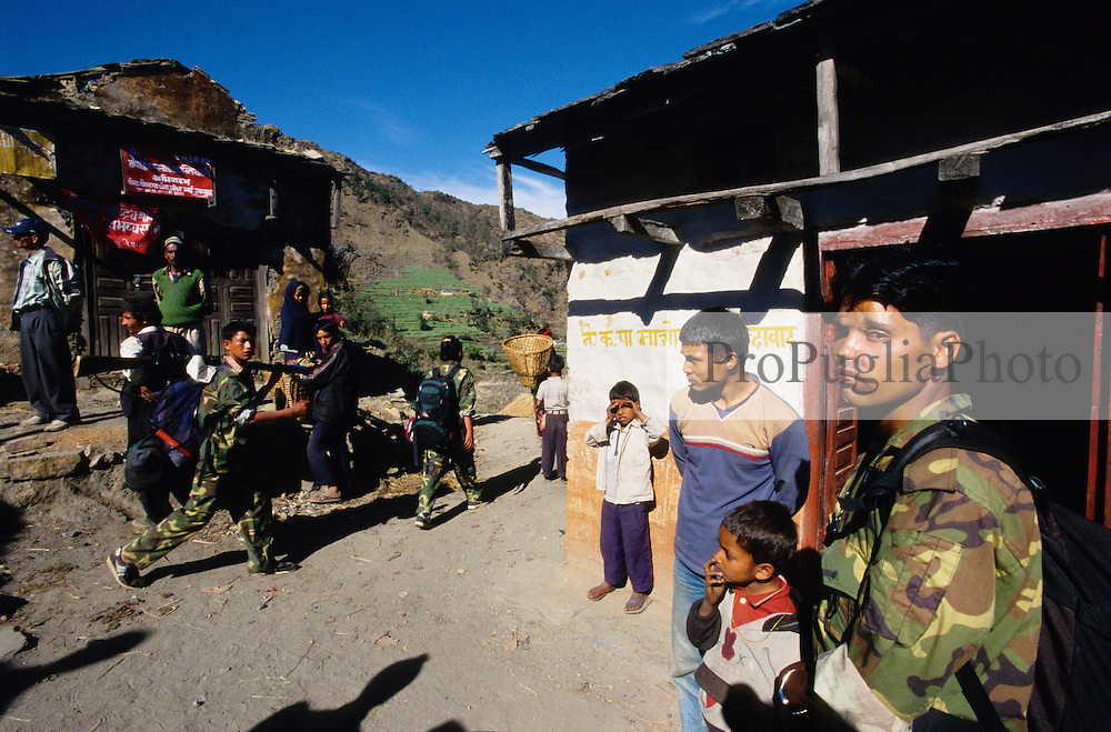 Kusapani, 03 March 2005..Soldiers of the Maoist Army in a village of Dailekh district. The Maoist militiamen are also know as 'The Red Army' or 'The People's Army' or 'Rebels' or 'Terrorists'.