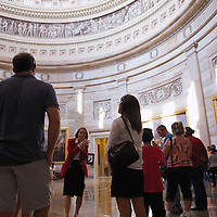 A tour pauses in the rotunda of the United States Capitol in Washington, DC.