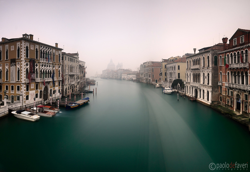 "An early, foggy morning view of the Canal Grande as seen from the bridge of Accademia, with the church of the Salute in the background. Taken on a morning of mid January about one hour after sunrise, this is stitched from five vertical frames each exposed for 120""."