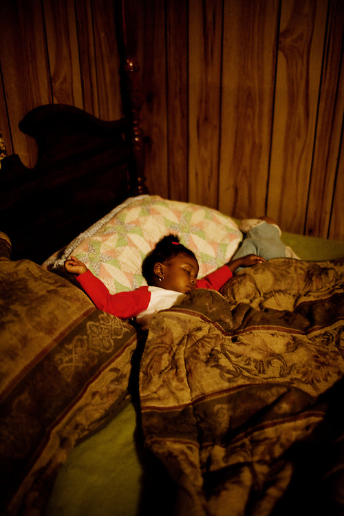 """Gabby, 2, sleeps in the bed she shares with her mother, Lettorea """"Lottie"""" Clark, 25, in Albany, GA on Wednesday, October 22, 2008. Lottie and Gabby live off welfare after escaping an abusive relationship with Gabby's father."""