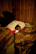 "Gabby, 2, sleeps in the bed she shares with her mother, Lettorea ""Lottie"" Clark, 25, in Albany, GA on Wednesday, October 22, 2008. Lottie and Gabby live off welfare after escaping an abusive relationship with Gabby's father."