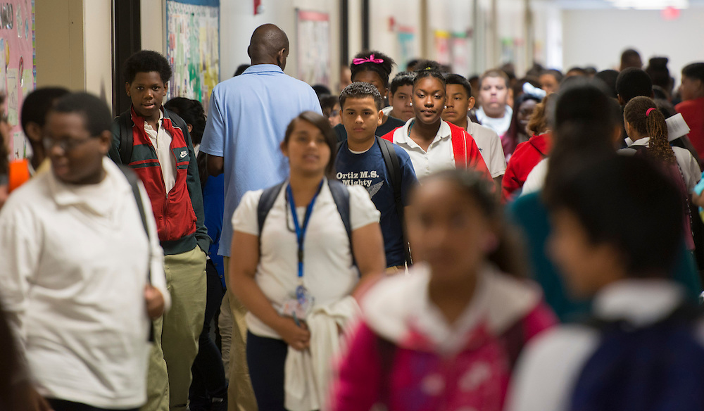 Students change classes during a Broad Foundation research team tour at Ortiz Middle School, May 29, 2013.