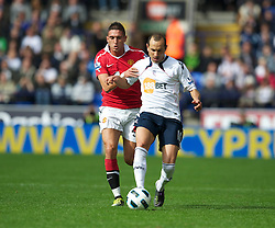BOLTON, ENGLAND - Sunday, September 26, 2010: Manchester United's Federico Macheda and Bolton Wanderers' Martin Petrov during the Premiership match at the Reebok Stadium. (Photo by David Rawcliffe/Propaganda)