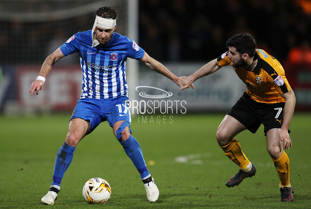 Piero Mingoia of Cambridge United and Nicky Deverdics of Hartlepool United in action during the EFL Sky Bet League 2 match between Cambridge United and Hartlepool United at the Cambs Glass Stadium, Cambridge, England on 14 March 2017. Photo by Harry Hubbard.