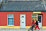 Irish women with child in stroller pushchair in street in Kilkee, County Clare, West of Ireland