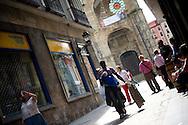 People walk in a street of the Northern Spanish Basque city of Bilbao, on August 25, 2011. Photo Rafa Rivas