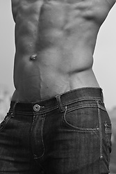 detail of a man wearing only jeans