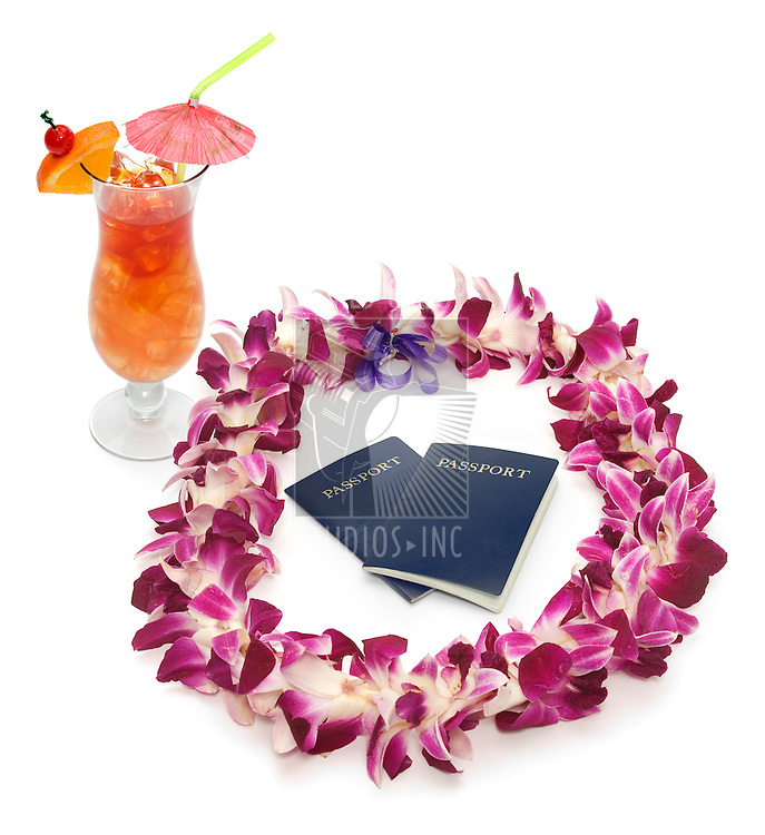 Polynesian/Hawaiian lei shot on white with two passports and a tropical drink