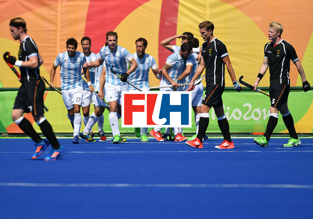 Argentina's players celebrate their fourth goal during the men's semifinal field hockey Argentina vs Germany match of the Rio 2016 Olympics Games at the Olympic Hockey Centre in Rio de Janeiro on August 16, 2016. / AFP / Pascal GUYOT        (Photo credit should read PASCAL GUYOT/AFP/Getty Images)