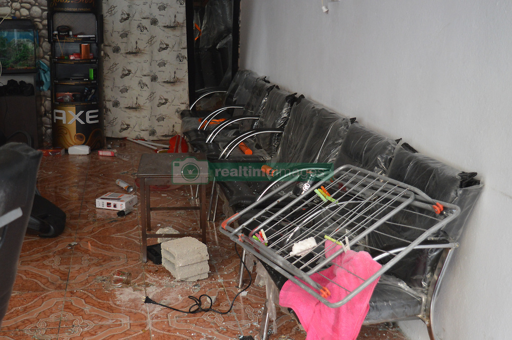July 4, 2017 - Ankara, Turkey - An Iraqi barber shop is seen heavily damaged after a conflict between Turkish citizens and Syrian refugees at Demetevler neighbourhood in Ankara, Turkey on July 04, 2017. In the last hours of July 03, a group of Syrian refugees conflicted with local residents as the police dispersed the two groups with water cannon vehicles and gas bombs at the neighbourhood. After the conflict, the residents took to the streets to protest against the Turkish government's refugee policy. As a result of the conflict, a person was injured, and numerous workplaces in the neighbourhood were damaged. (Credit Image: © Altan Gocher/NurPhoto via ZUMA Press)