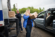 Dixie Shaw loads food into recipients cars at a drive-up food distribution in Monticello, ME