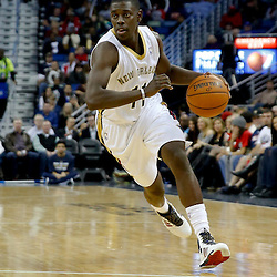 Dec 11, 2013; New Orleans, LA, USA; New Orleans Pelicans point guard Jrue Holiday (11) against the Detroit Pistons during the second quarter at New Orleans Arena. Mandatory Credit: Derick E. Hingle-USA TODAY Sports
