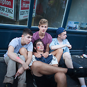 Tired white boys intoxicated after a long day in the sun. The streets are emptying quickly as the sun sets and the parades are over. The Notting Hill Carnival has been running since 1966 and is every year attended by up to a million people. The carnival is a mix of amazing dance parades and street parties with a distinct Caribbean feel.