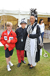 Left to right, OSCAR AYTON, NIMMY MARCH and her son MALACHY BURKE at a luncheon hosted by Cartier for their sponsorship of the Style et Luxe part of the Goodwood Festival of Speed at Goodwood House, West Sussex on 1st July 2012.