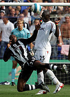 Photo: Paul Thomas. <br /> Bolton Wanderers v Newcastle United. Barclays Premiership. 11/08/2007. <br /> <br /> Shola Ameobi (L) is fouled by Abdoulaye Faye of Bolton.