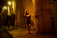 A woman leaves Tu Candela with foreign tourists near the clock tower in the historic center of Cartagena, Colombia. Tu Candela is a discotec popular among foreign tourists, where they can drink, dance and to pick up prostitutes. Tu Candela is where the prostitute at the heart of the secret service scandal regularly went to pick up clients.