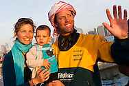 UAE. 4th January 2012. Volvo Ocean Race, Leg 2, arrival into Abu Dhabi. Arrivals ceremony. Iker Martinez skipper of Team Telefonica with his wife and son.