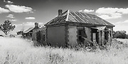 dilapidated old sandstone farm house in a field of long dry grass near Palmer, South Australia, Australia<br />