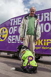 © Licensed to London News Pictures . 02/06/2014 . Newark , Nottinghamshire , UK . NEIL HAMILTON supporting UKIP with a dog wearing UKIP rosettes in Market Square , Newark , today (Monday 2nd June 2014), ahead of the by-election due to take place on Thursday (5th June 2014) . Photo credit : Joel Goodman/LNP