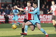 Kevin Dawson and Joe Jacobson during the EFL Sky Bet League 2 match between Cheltenham Town and Wycombe Wanderers at LCI Rail Stadium, Cheltenham, England on 17 February 2018. Picture by Antony Thompson.