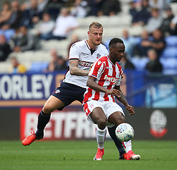 Saido Berahino of Stoke City and David Wheater of Bolton Wanderers (L) in action - Mandatory by-line: Jack Phillips/JMP - 29/07/2017 - FOOTBALL - Macron Stadium - Bolton, England - Bolton Wanderers v Stoke City - Pre-Season Club Friendly