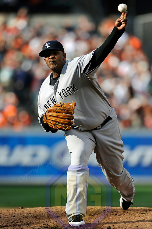 06 April 2009:  New York Yankees starting pitcher CC Sabathia (52) pitches in the 4th inning against the Baltimore Orioles at Camden Yards in Baltimore, MD.  Sabathia walked five and gave up six earned runs as the Orioles defeated the Yankees 10-5 in the home opener to start the major league regular season.  ****For Editorial Use Only****