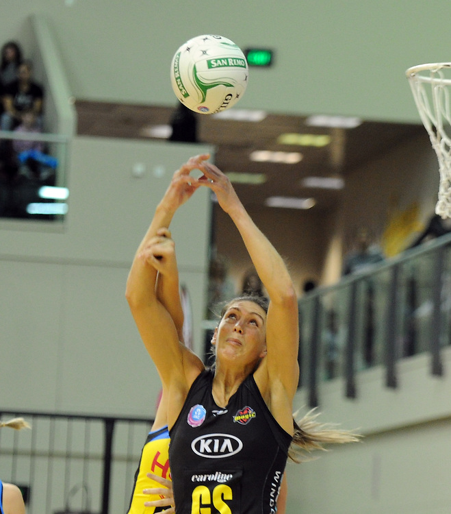 Magics' Irene van Dyk contests the ball with the Pulses' Katrina Grant in the ANZ Netball Champions at TSB Stadium, Wellington, New Zealand, Sunday, April 28, 2013. Credit:SNPA / Ross Setford