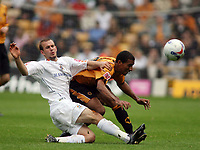 Photo: Rich Eaton.<br /> <br /> Wolverhampton Wanderers v Luton Town. Coca Cola Championship. 26/08/2006. Sol Davis left of Luton and CArl Cort of Wolves clash