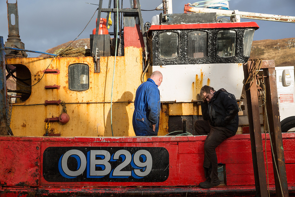 Mallaig Boatyard. Engineer Oliver Weir (R) after the stressful job of attaching the vessel to the cradle. Picture Robert Perry 9th April 2016<br /> <br /> Must credit photo to Robert Perry<br /> FEE PAYABLE FOR REPRO USE<br /> FEE PAYABLE FOR ALL INTERNET USE<br /> www.robertperry.co.uk<br /> NB -This image is not to be distributed without the prior consent of the copyright holder.<br /> in using this image you agree to abide by terms and conditions as stated in this caption.<br /> All monies payable to Robert Perry<br /> <br /> (PLEASE DO NOT REMOVE THIS CAPTION)<br /> This image is intended for Editorial use (e.g. news). Any commercial or promotional use requires additional clearance. <br /> Copyright 2014 All rights protected.<br /> first use only<br /> contact details<br /> Robert Perry     <br /> 07702 631 477<br /> robertperryphotos@gmail.com<br /> no internet usage without prior consent.         <br /> Robert Perry reserves the right to pursue unauthorised use of this image . If you violate my intellectual property you may be liable for  damages, loss of income, and profits you derive from the use of this image.
