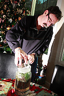 Jerry Woodbury with a terrarium he made in an art class, photographed at home in Kettering, Saturday, December 22, 2012.