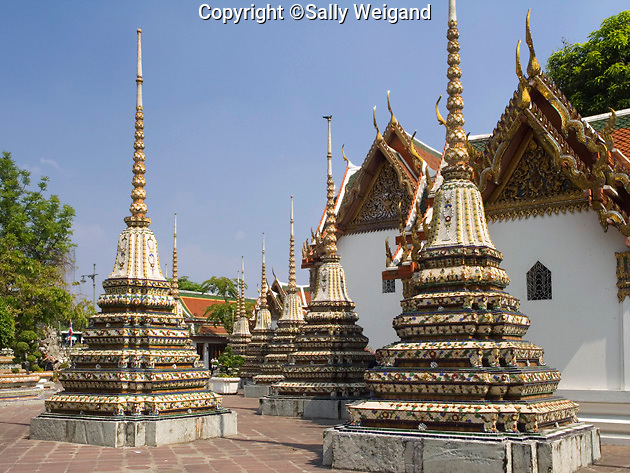 many chedi with ornate tile pattern,pavilion in Thai architecture,Wat Pho; Buddhist temple
