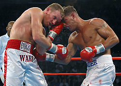 June 7, 2003; Atlantic City, NJ; USA; Mickey Ward (l) and Arturo Gatti (r) trade punches during their third and final bout at Boardwalk Hall in Atlantic City, NJ.  Gatti won the bout via unanimous decision.
