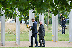 © London News Pictures. 07/07/15. London, UK. Prince William lays some flowers at the 7/7 Memorial in Hyde Park to mark the 10 year anniversary of the 7/7 London bombings, Central London. Photo credit: Laura Lean/LNP