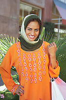 Portrait of muslim woman with shopping bags