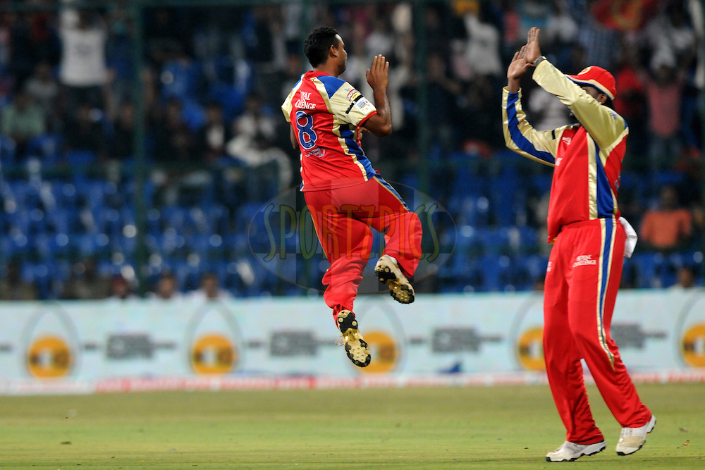 Jamaluddin Syed Mohammed of Royal Challengers Bangalore celebrate a wicket during match 1 of the NOKIA Champions League T20 ( CLT20 )between the Royal Challengers Bangalore and the Warriors held at the  M.Chinnaswamy Stadium in Bangalore , Karnataka, India on the 23rd September 2011..Photo by Pal Pillai/BCCI/SPORTZPICS