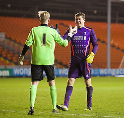 BLACKPOOL, ENGLAND - Wednesday, December 18, 2013: Liverpool's goalkeeper Ryan Crump and Blackpool's goalkeeper Connor Hunt embrace before the penalty shoot-out during the FA Youth Cup 3rd Round match at Bloomfield Road. (Pic by David Rawcliffe/Propaganda)