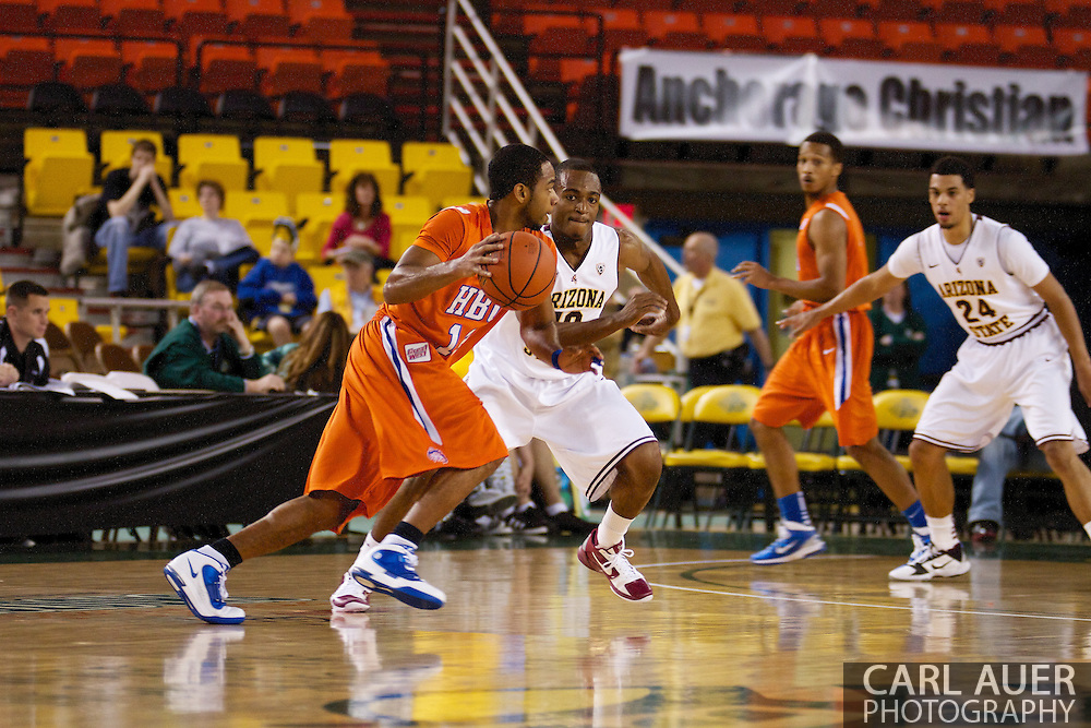 November 25th, 2010:  Anchorage, Alaska - Houston Baptist guard Michael Moss (12) drives in the Huskies loss to the Arizona State Sun Devils 55-73 in the first round of the Great Alaska Shootout.
