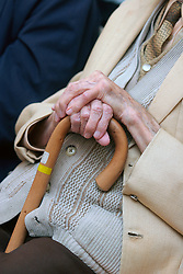 Elderly man holding walking stick UK