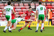 11th November 2018 , Racecourse Ground,  Wrexham, Wales ;  Rugby League World Cup Qualifier,Wales v Ireland ; James Olds of Wales evades the tackle of Ethan Ryan of Ireland <br /> <br /> <br /> Credit:   Craig Thomas/Replay Images