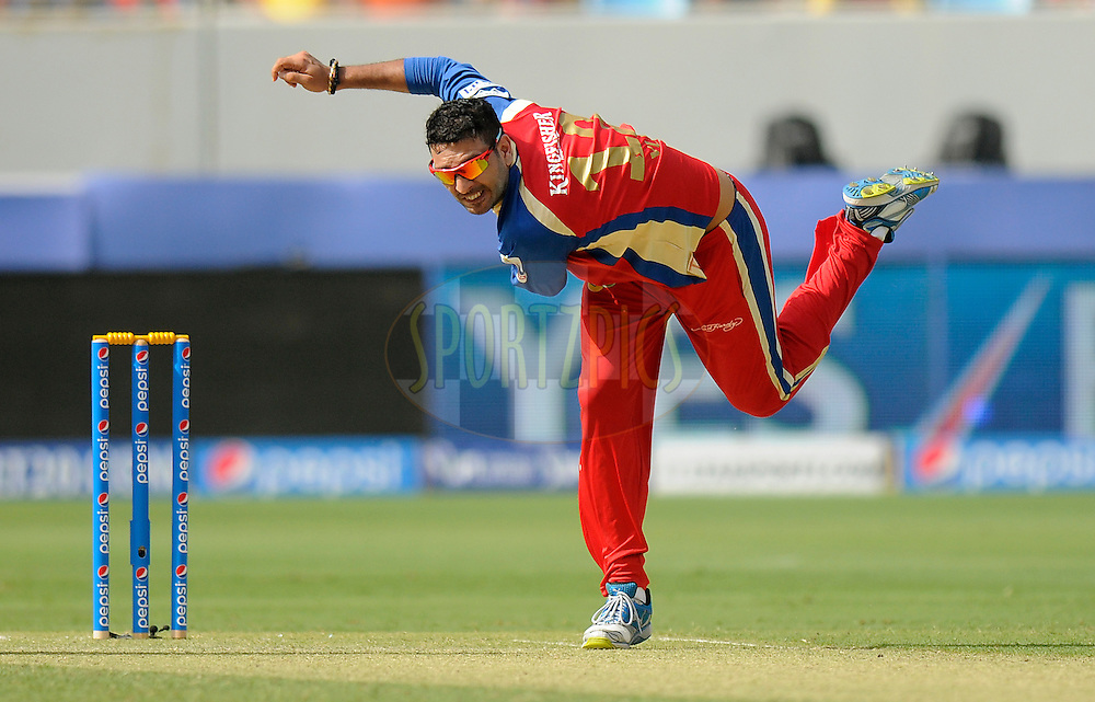 Yuvraj Singh of the Royal Challengers Bangalore bowls during match 5 of the Pepsi Indian Premier League Season 7 between the Royal Challengers Bangalore and the Mumbai Indians held at the Dubai International Cricket Stadium, Dubai, United Arab Emirates on the 19th April 2014<br /> <br /> Photo by Pal Pillai / IPL / SPORTZPICS