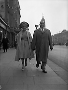 "20/04/1959<br /> 04/20/1959<br /> 20 April 1959<br /> Miss May O'Callaghan an actress from  Kilburn, London and Mr. Mike ""Butty"" Sugrue (circus strongman, entrepreneur and boxing promoter) on O'Connell Street, Dublin."